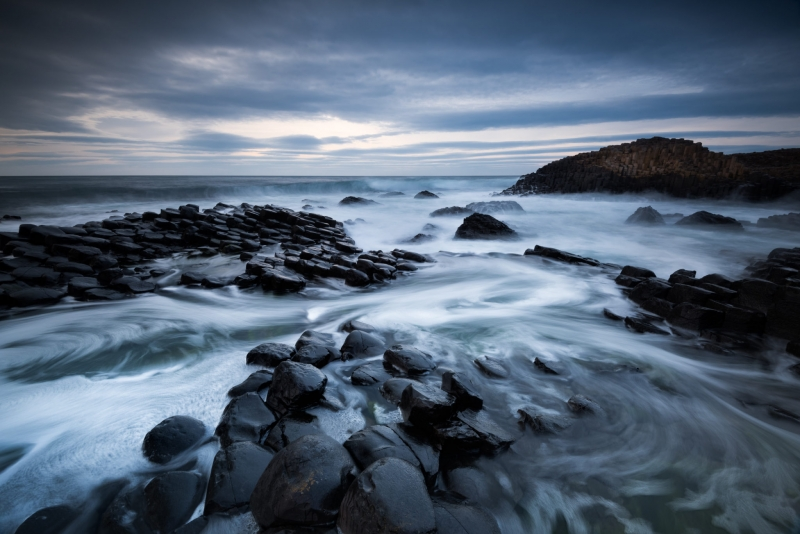 Waves thunder in around me as I risk life and limb to get the long exposure landscape photo I have in mind. Dark, moody with tonnes and drama - just the way I like my work.