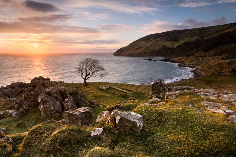 Early morning sunrays cast their warmth across Murlough Bay, co Antrim in Northern Ireland. A remote but stunning location.....