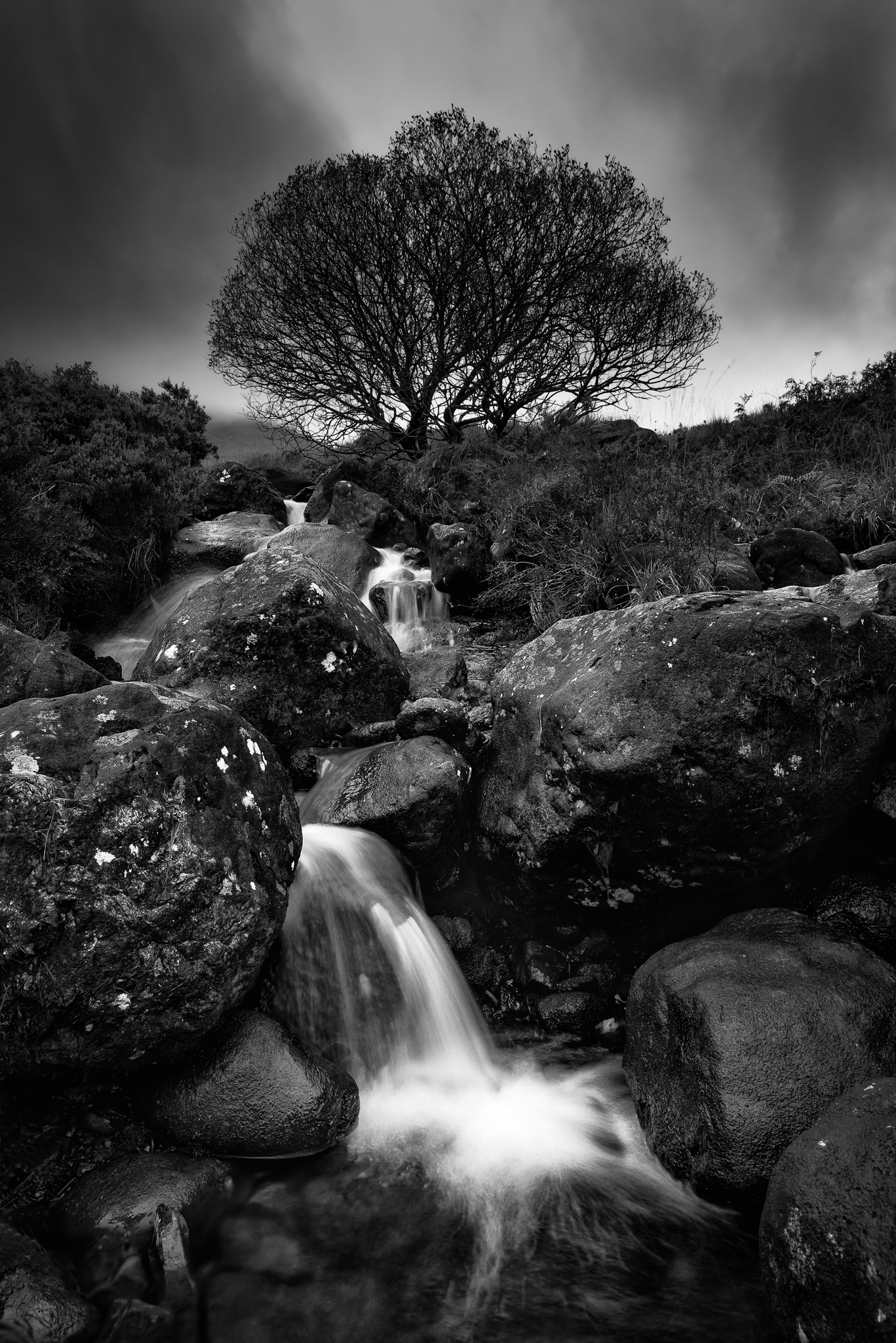 A small waterfall off the edge of the fairy pools on the Isle of Skye in Scotland